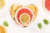 Fotografie Fresh fruits. Mixed citrus fruits. Healthy diet eating. Top view