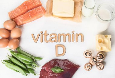 Top view of natural foods rich in vitamin D on white background