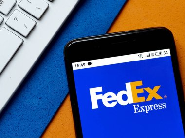 In this photo illustration FedEx Corporation logo is seen displayed on a smartphone