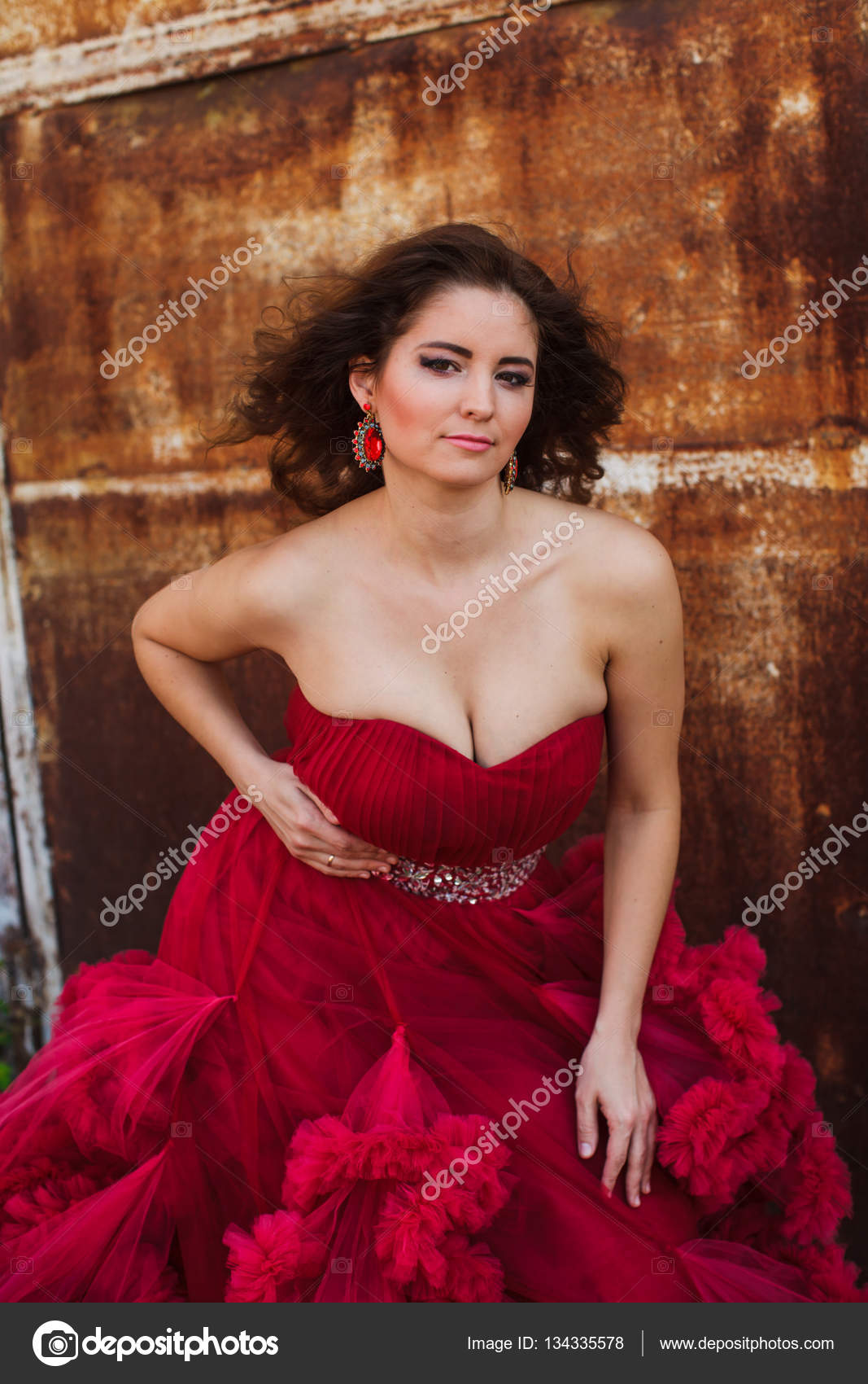 Woman In Cloudy Red Dress Rustic Style Stock Photo