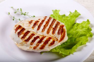 Grilled turkey steak with thyme leaves