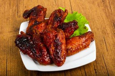 Chicken wings in teriyaki sauce stock vector