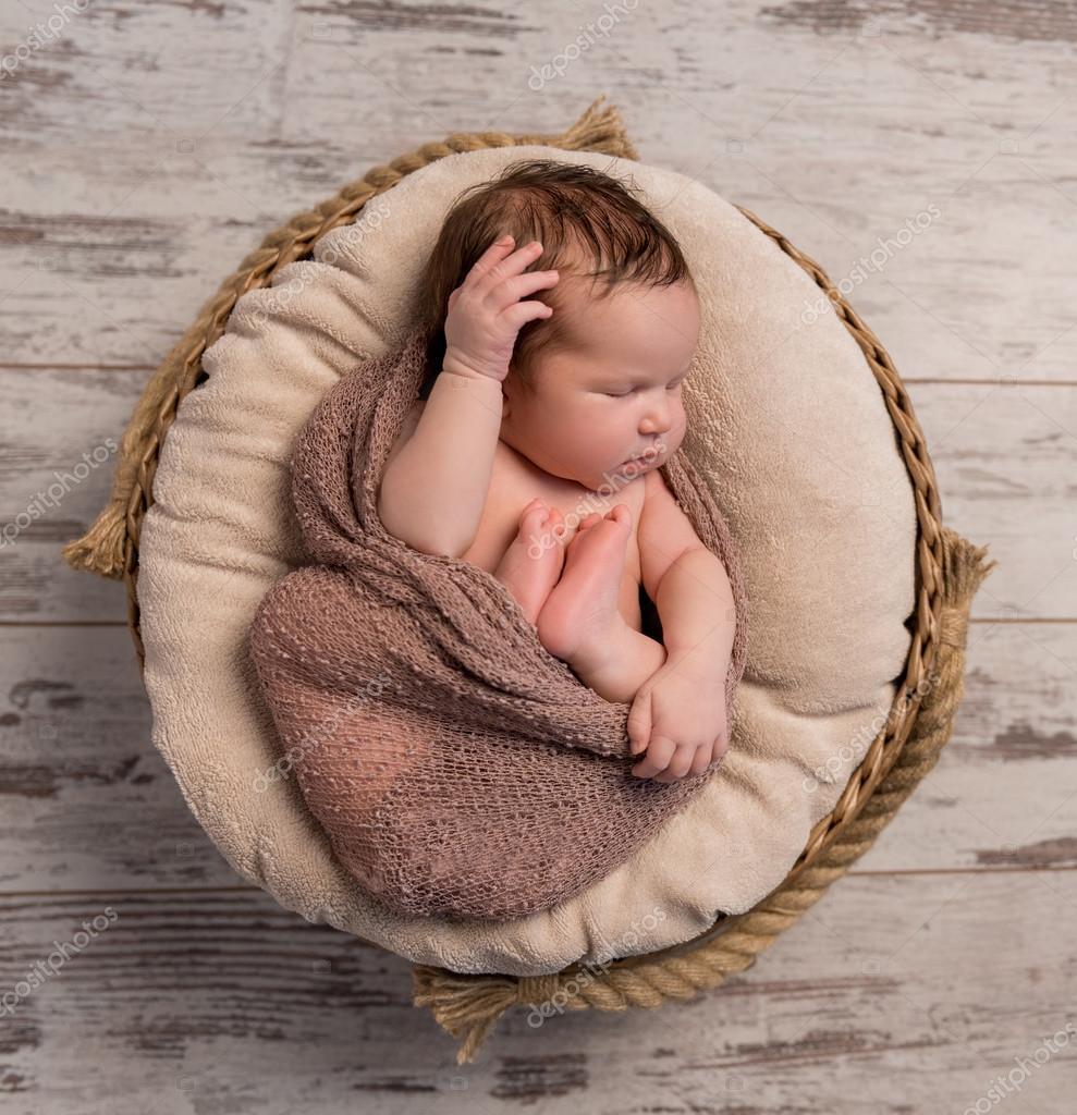 1452595b0 sleepy baby with folded legs and hands — Stock Photo © tan4ikk ...