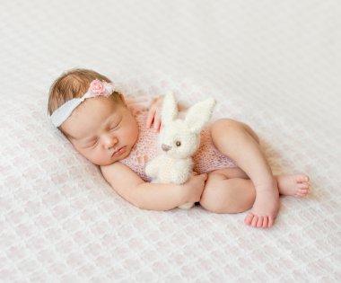 sleeping newborn girl with headband