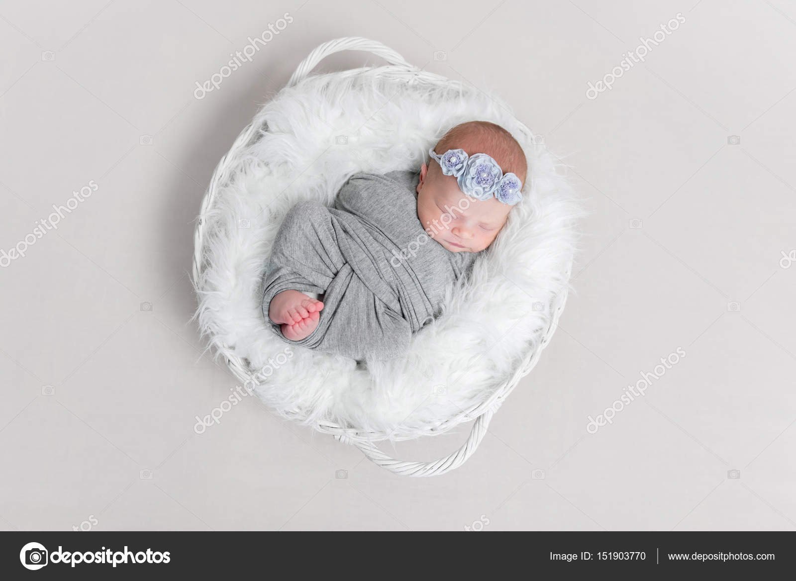 Baby Wrapped In Blanket In White Basket Topview Stock Photo