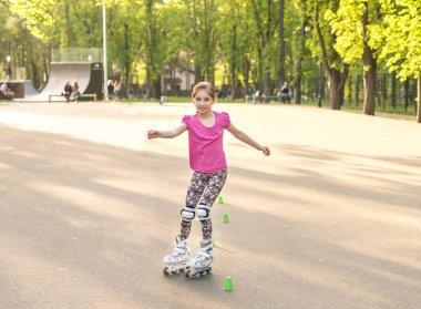 teenage girl skating wearing knee protection