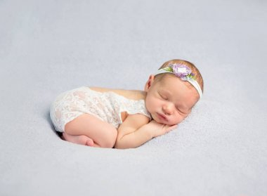 Adorable newborn baby in bodysuit