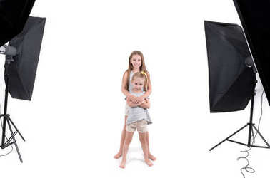 Two young girls in photo studio