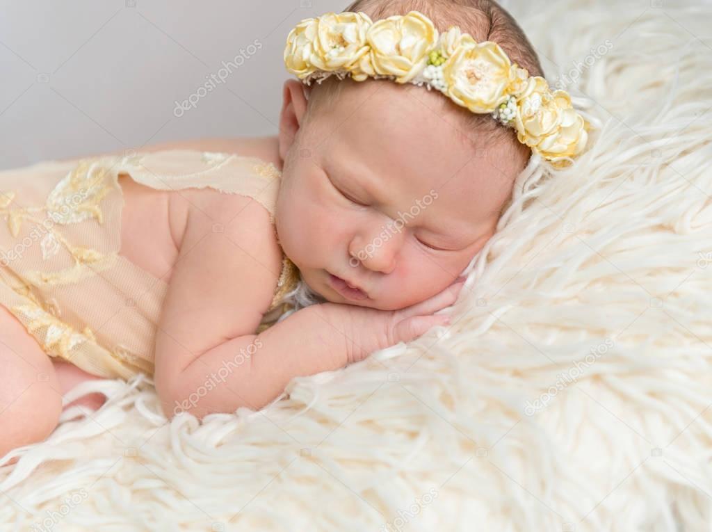 Little baby girl sleeping on her side