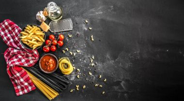 Uncooked variety of pasta with spices