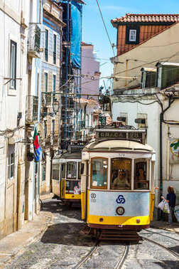 LISBON, PORTUGAL - JULY 30, 2017 : Vintage tram in the city center of Lisbon, Portugal in a summer day
