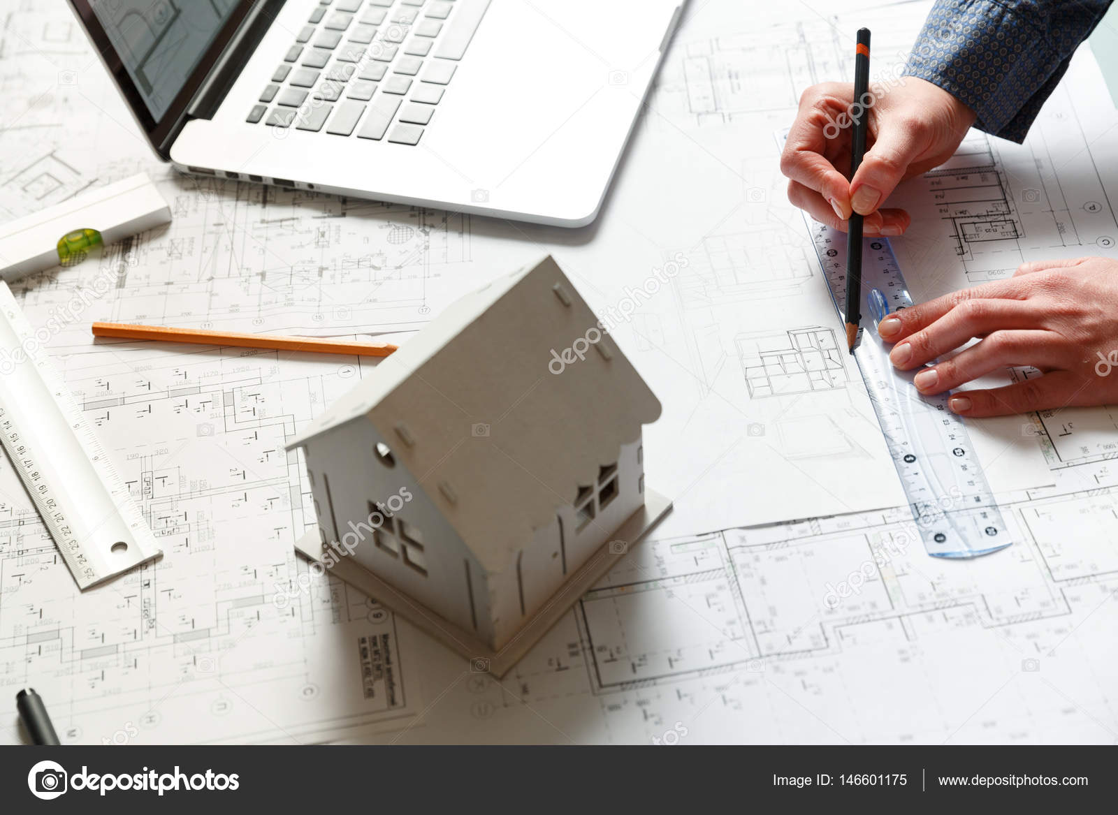 Designer works on a blueprint of new apartments stock photo designer works on a blueprint of new apartments stock photo malvernweather Gallery