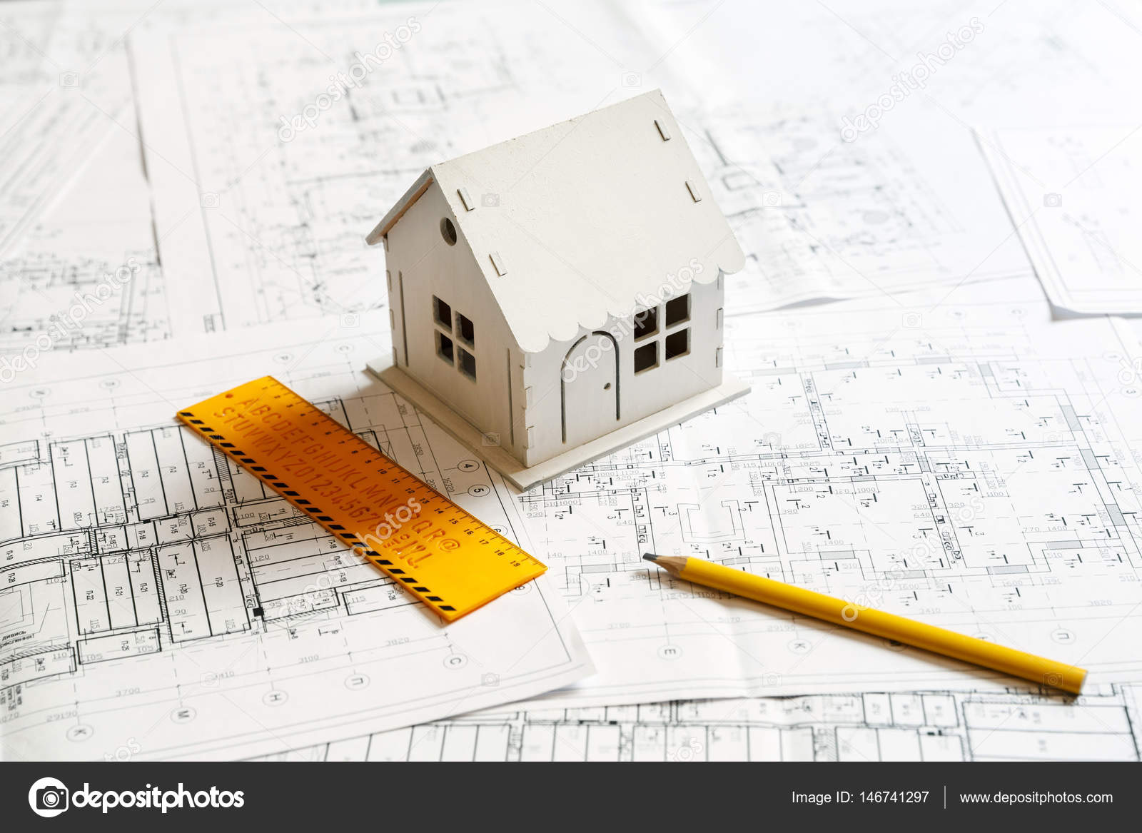 Model of a house on top of blueprints and architect tools stock model of a house on top of blueprints and architect tools stock photo malvernweather Choice Image