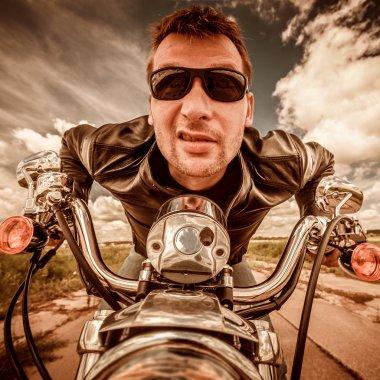Funny Biker racing on the road
