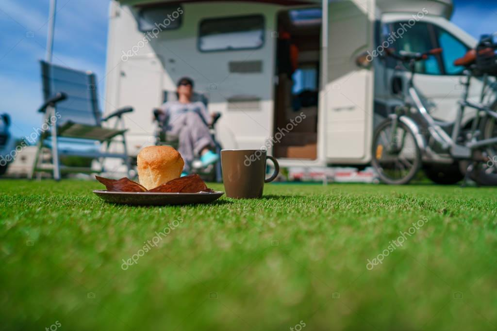 Coffee Mug on grass. Family vacation travel, holiday trip in mot