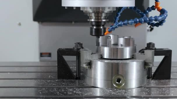 Metalworking CNC milling machine. Cutting metal modern processing technology.