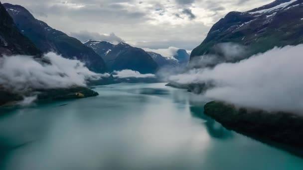 Beautiful Nature Norway natural landscape lovatnet lake flying over the clouds.