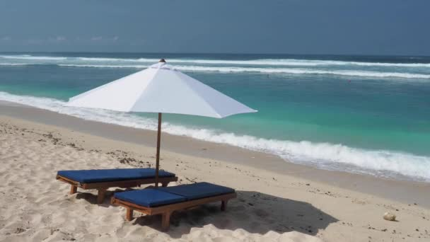 Beach chair and umbrella on tropical sand beach