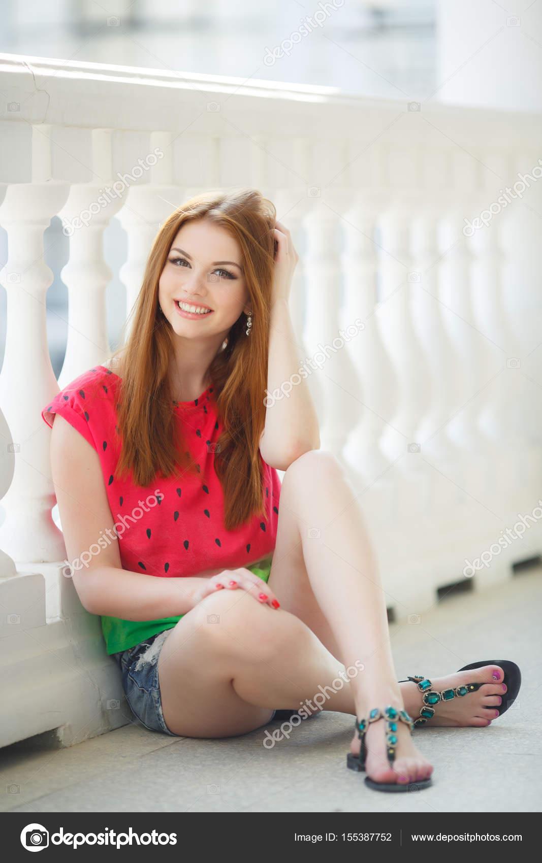 Plump redhead posing