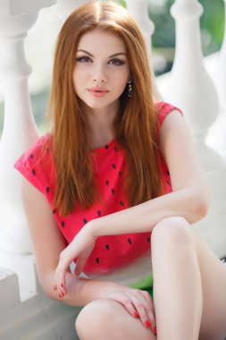 Portrait of beautiful young girl with gorgeous red hair