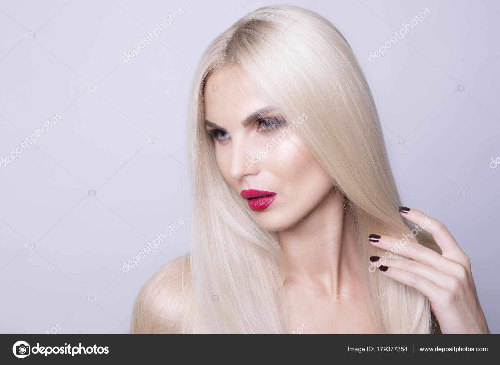 Luxury Platinum Blonde Hair Color And Red Lips Stock Photo