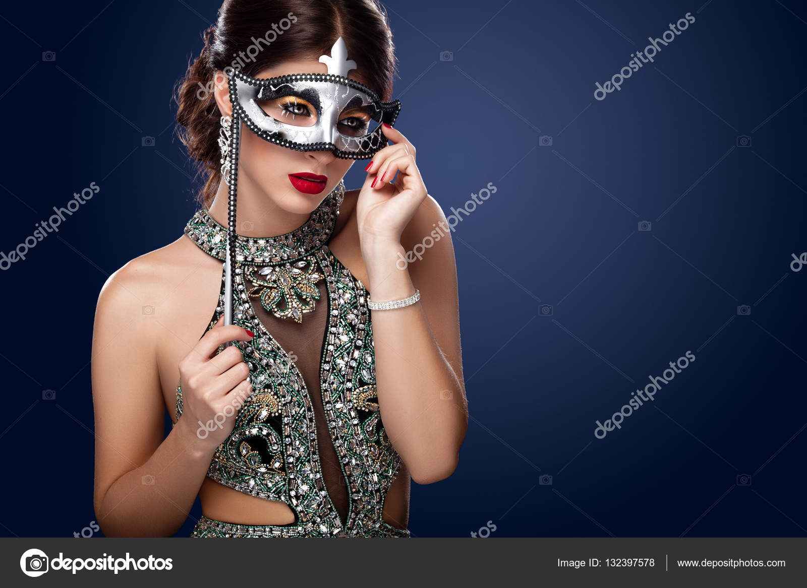 0ac7494cbd2c9 Beauty model woman wearing venetian masquerade carnival mask at party over  holiday dark background. Christmas and New Year celebration.