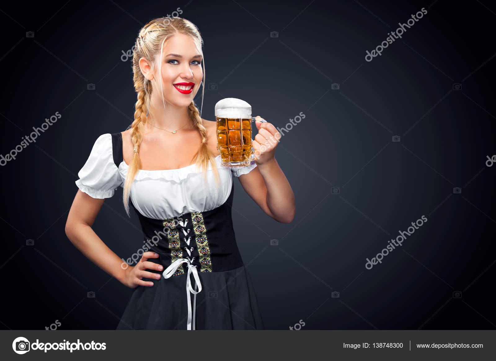 Young sexy Oktoberfest waitress, wearing a traditional Bavarian ...