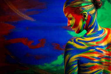 Color art face of woman for inspiration. Abstract portrait of the bright beautiful girl with colorful make-up and bodyart.