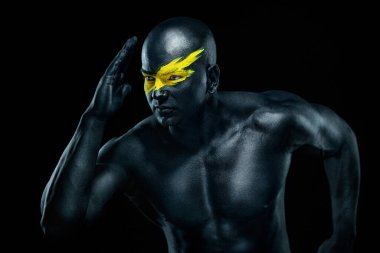 Sprinter and runner man. Running concept. Fitness and sport motivation. Strong and fit athletic, guy in body paint sprinter or runner, running on black background.