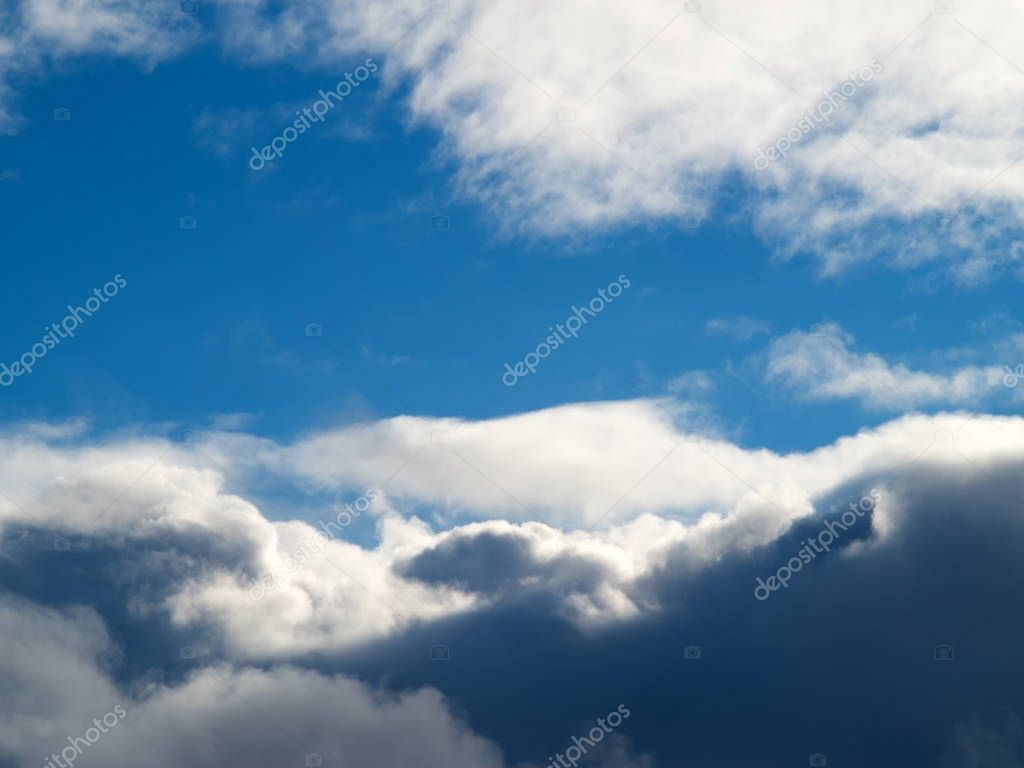 huge clouds on a blue sky background.