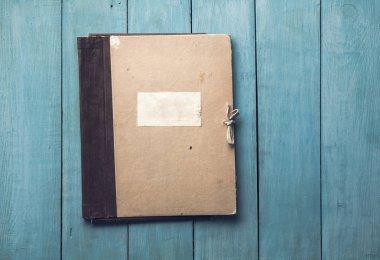 folder on wooden background