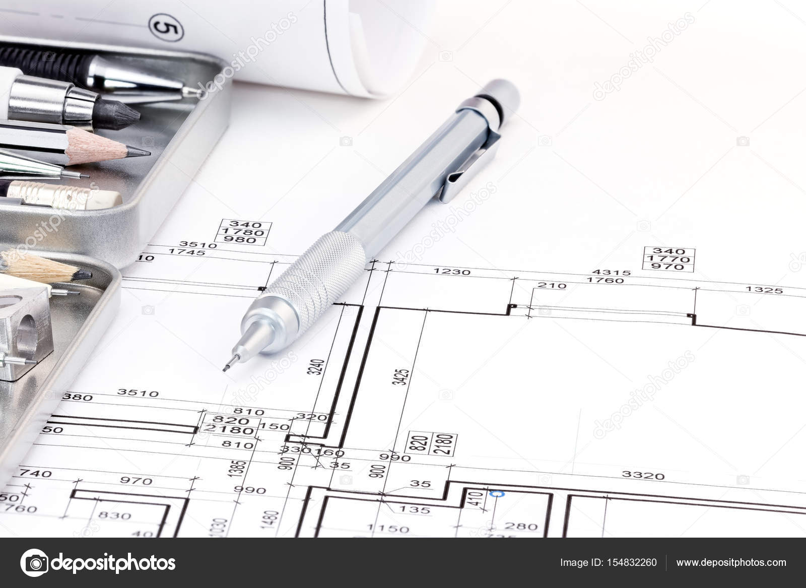 Architects Drawing Tools And Architectural Plan Of Apartment Stock Photo