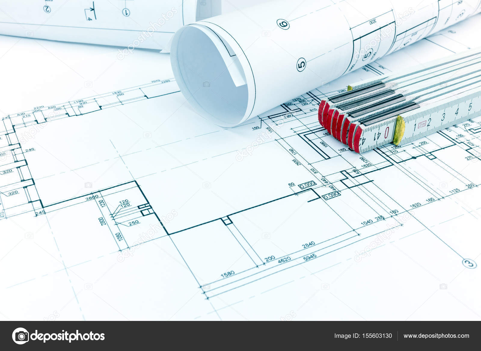 House plan rolls of architect blueprints and folding ruler on desk house plan rolls of architect blueprints and folding ruler on desk stock photo malvernweather Images