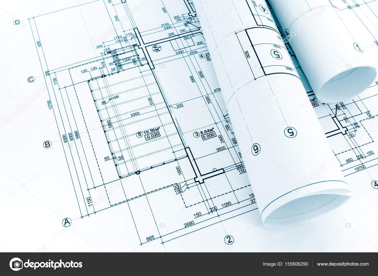 House plan with rolled blueprints on desk architectural background house plan with rolled blueprints on desk architectural background stock photo malvernweather Image collections