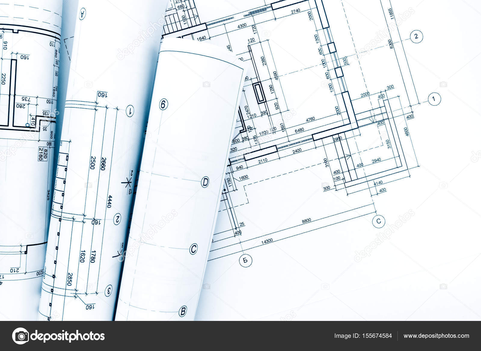 Architectural project drawings blueprint rolls on house plan architectural project drawings blueprint rolls on house plan photo by mrtwister malvernweather Images