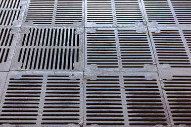 iron gutter grates and metal vent grids. industrial background.