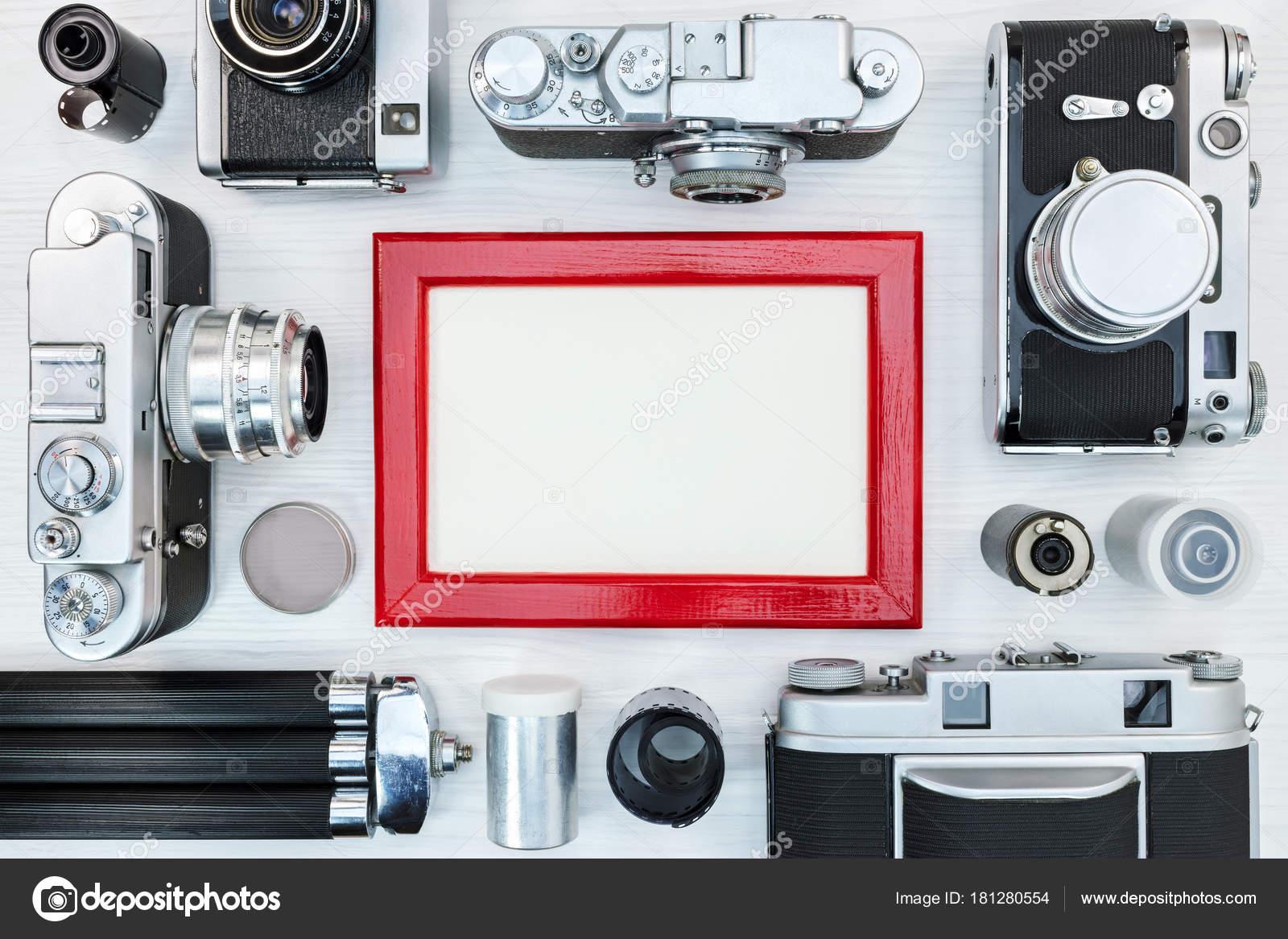 antiguas cámaras retras, películas del rodillo, trípode y marco de ...
