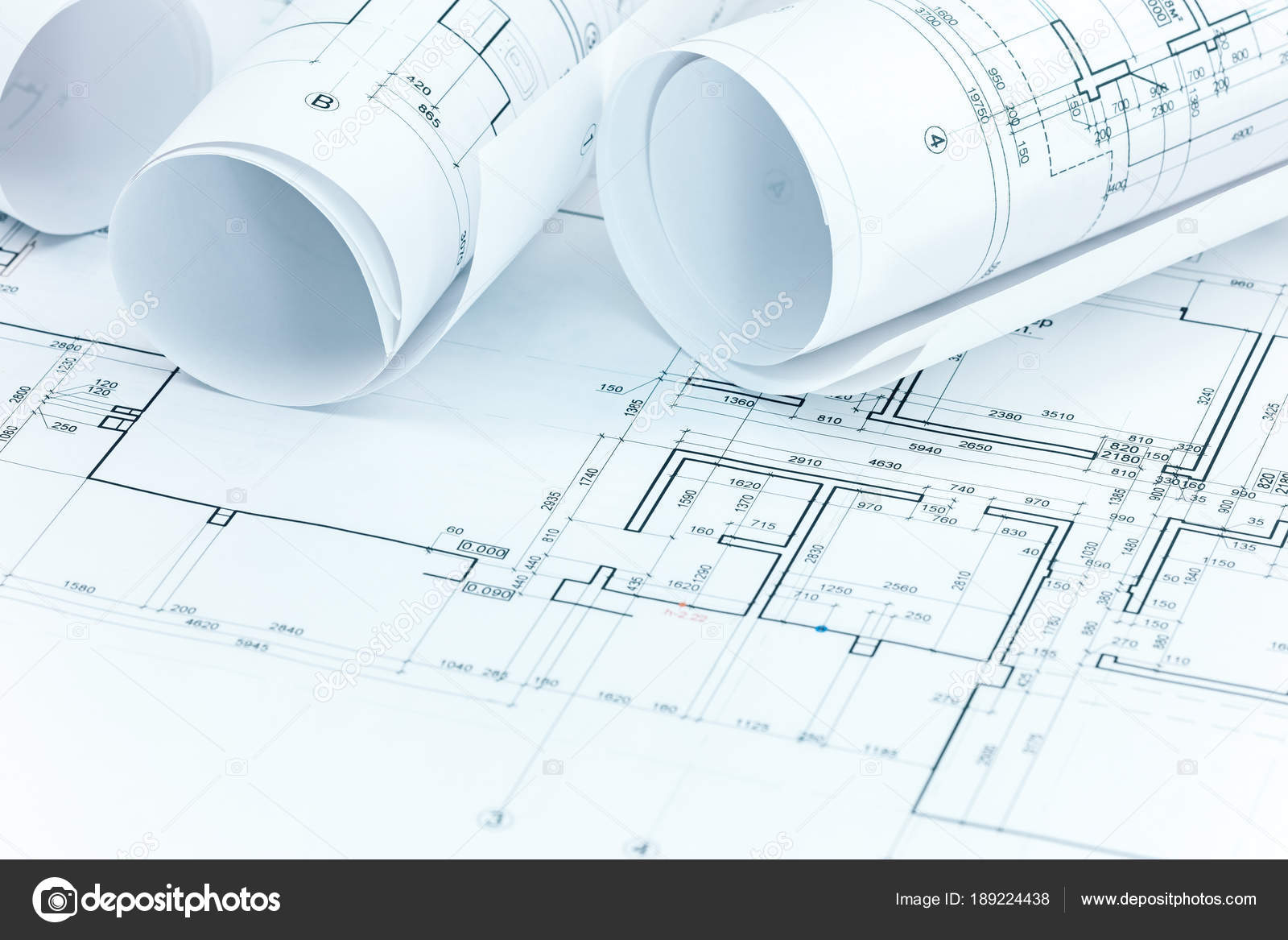 Set of construction plans and blueprint rolls on architect workplace set of construction plans and blueprint rolls on architect workplace stock photo malvernweather Images