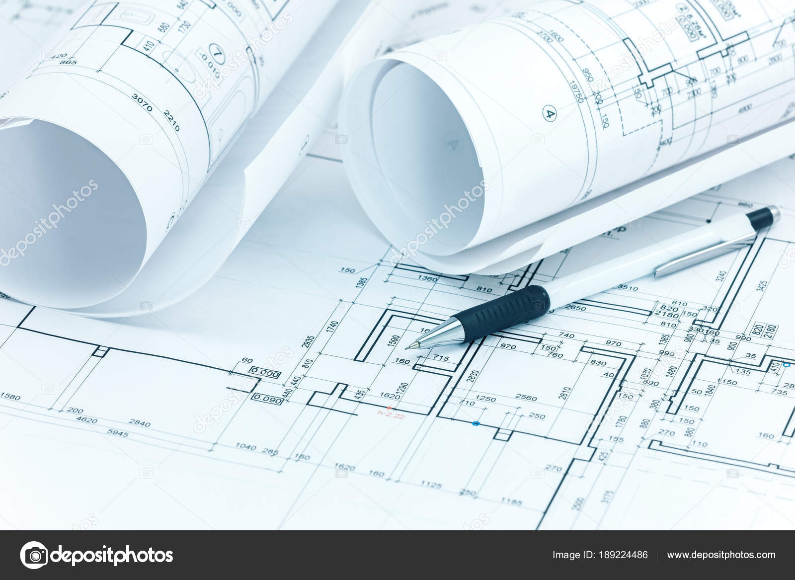 Architectural plans blueprint rolls and pencil on architect desk architectural plans blueprint rolls and pencil on architect desk stock photo malvernweather Gallery