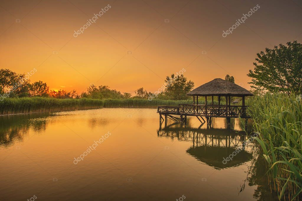A beautiful lake and a gazebo on it