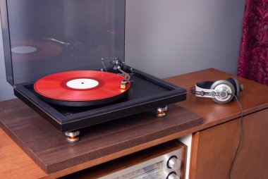 Vintage Stereo Turntable Plays Red Vinyl Record Album