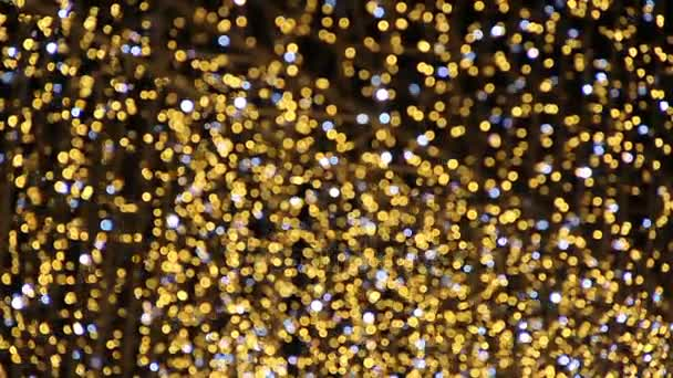 Arany csillogó bokeh fények, karácsonyi díszek