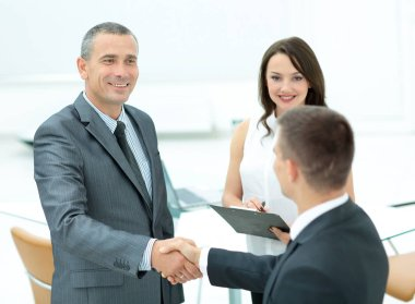 Successful handshake of business men before signing a contract