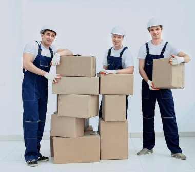 stevedores unload boxes in new premises