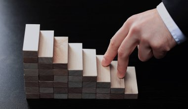 Hand climbing stairs made by wooden blocks