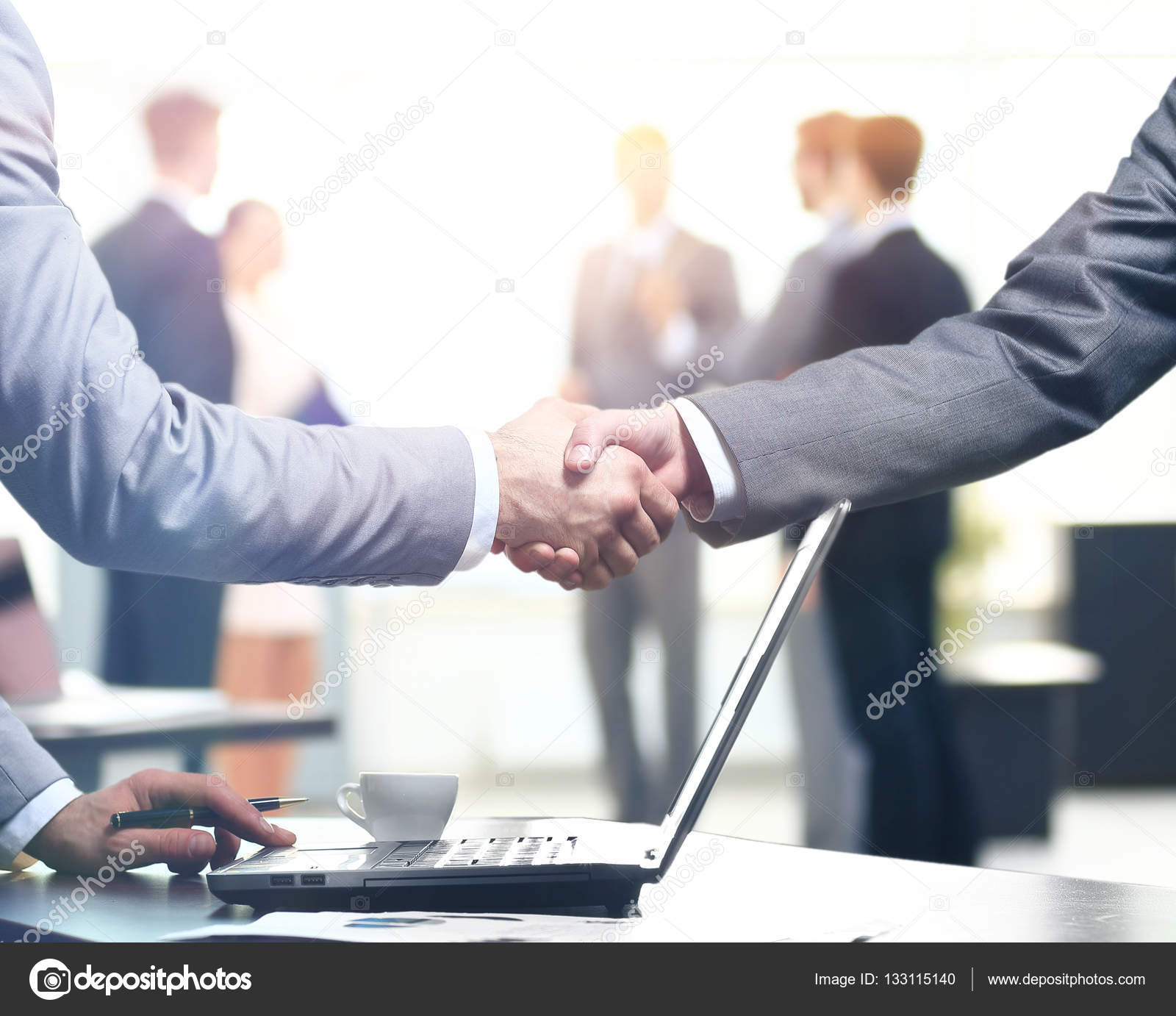 Business people handshake greeting deal at work photo free download - Confident Business Handshake Close Up View Of A Handshake Business Office In Formal Wear And Work At A Laptop Stock Image