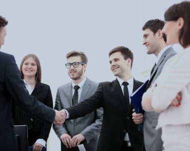 lawyers of the companies and business partners shake hands after