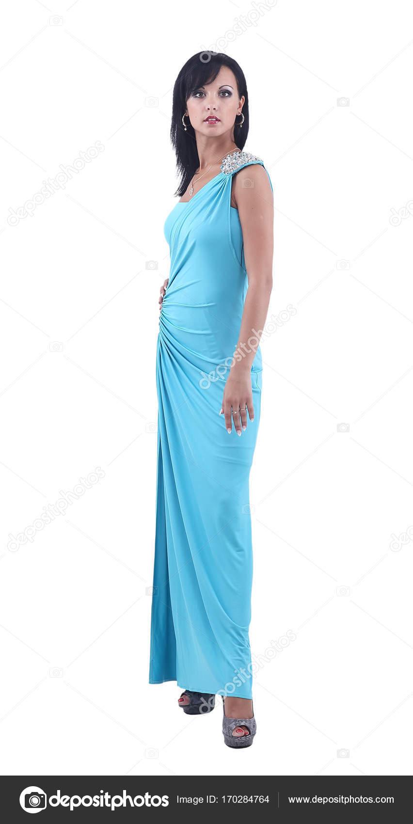 9c0469637405 Krásná žena v modré dlouhé šaty pózuje na bílém pozadí– stock obrázky