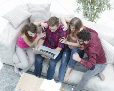 group of friends looking at the photo on the laptop.