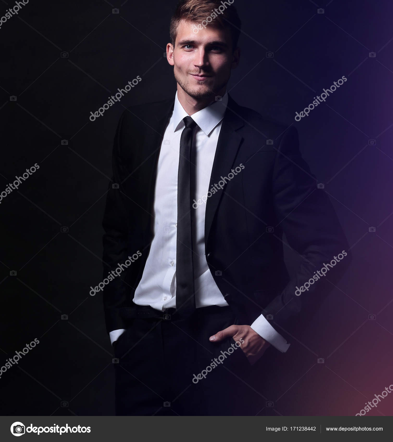 d3832df88b Happy business man wearing black suit isolated on white background — Photo  by ...